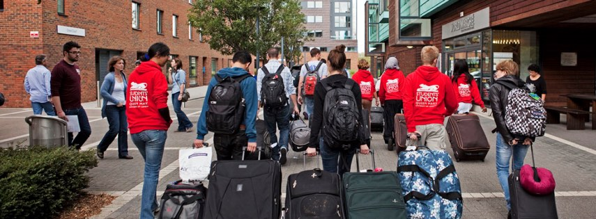 students with suitcases