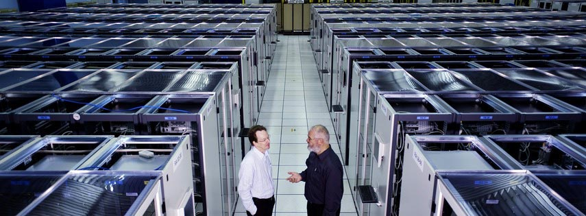 One of the data centres at CERN, with two people talking in the foreground. Image: CERN