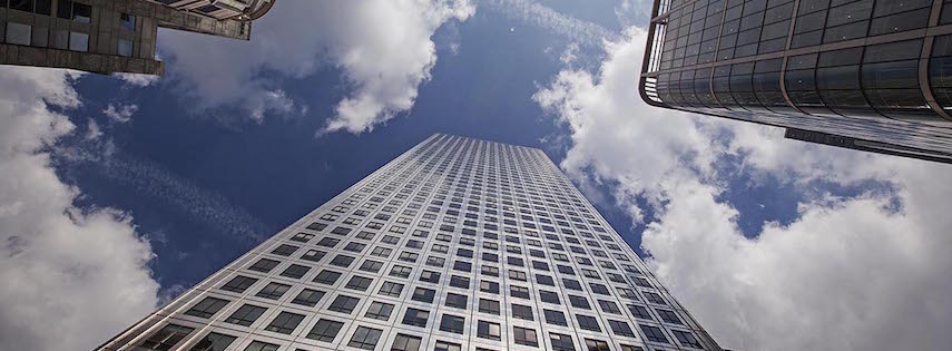 View of skyscrapers and blue sky from below