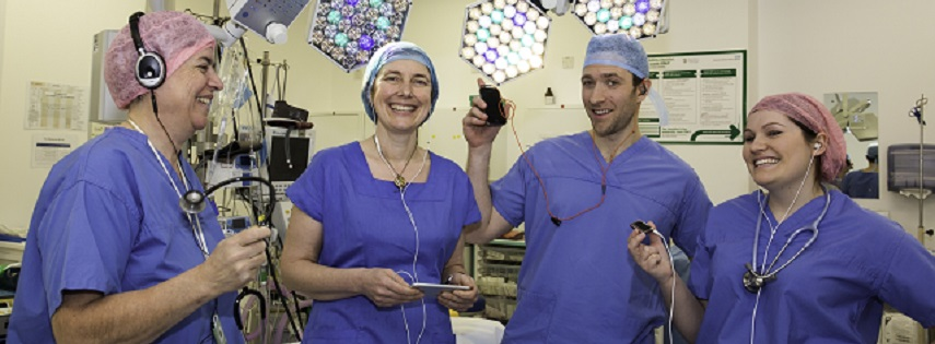Surgeons listening to portable music devices
