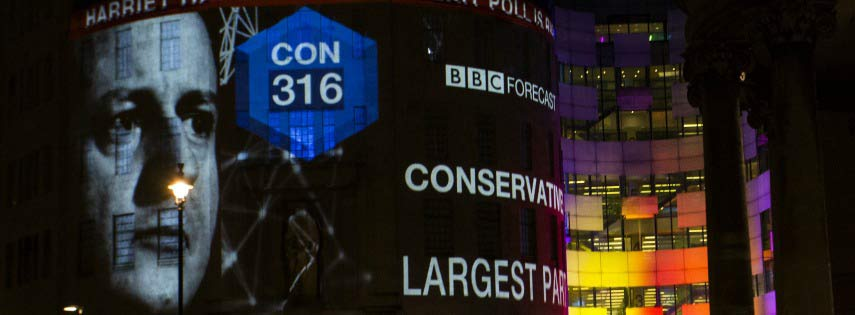 David Cameron Projected on building