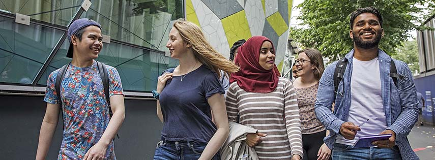 Students walking through Mile End campus