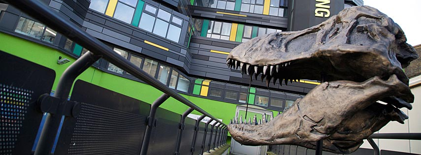 Life-sized cast of a Tyrannosaurus rex skull outside the G.E. Fogg building at Queen Mary University of London